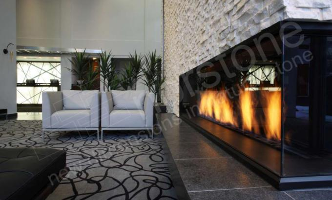 Cantilever Fireplace in Hotel Lobby with White Stone Veneer