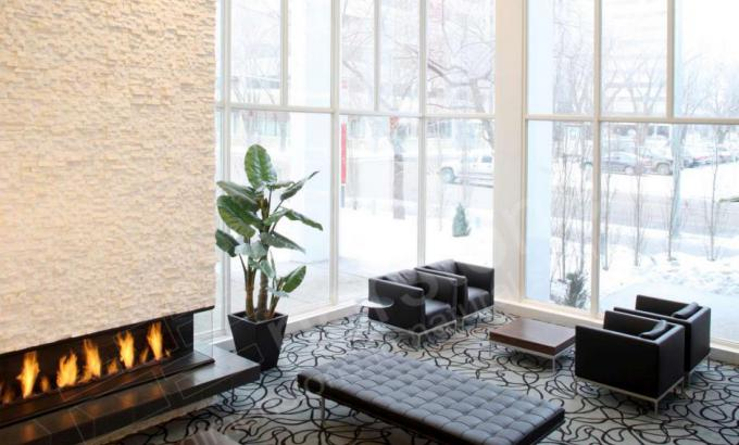 Two Story White Stone Veneer Fireplace in Alberta Canada