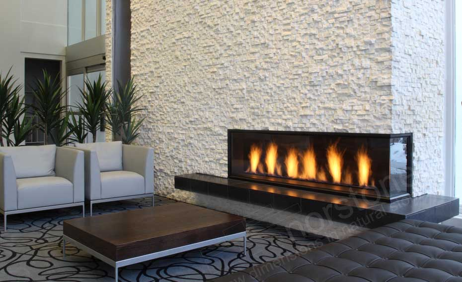 Modern White Fireplace with designer furniture in hotel lobby
