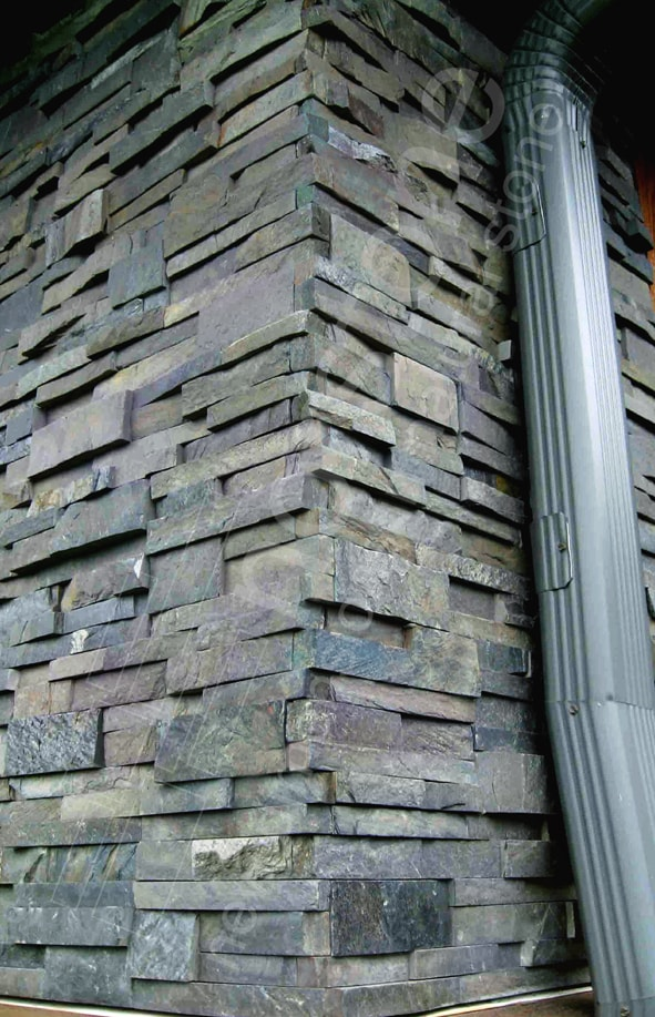 Norstone Charcoal Rock Panels showing vertical corner along side of house with rain downspout