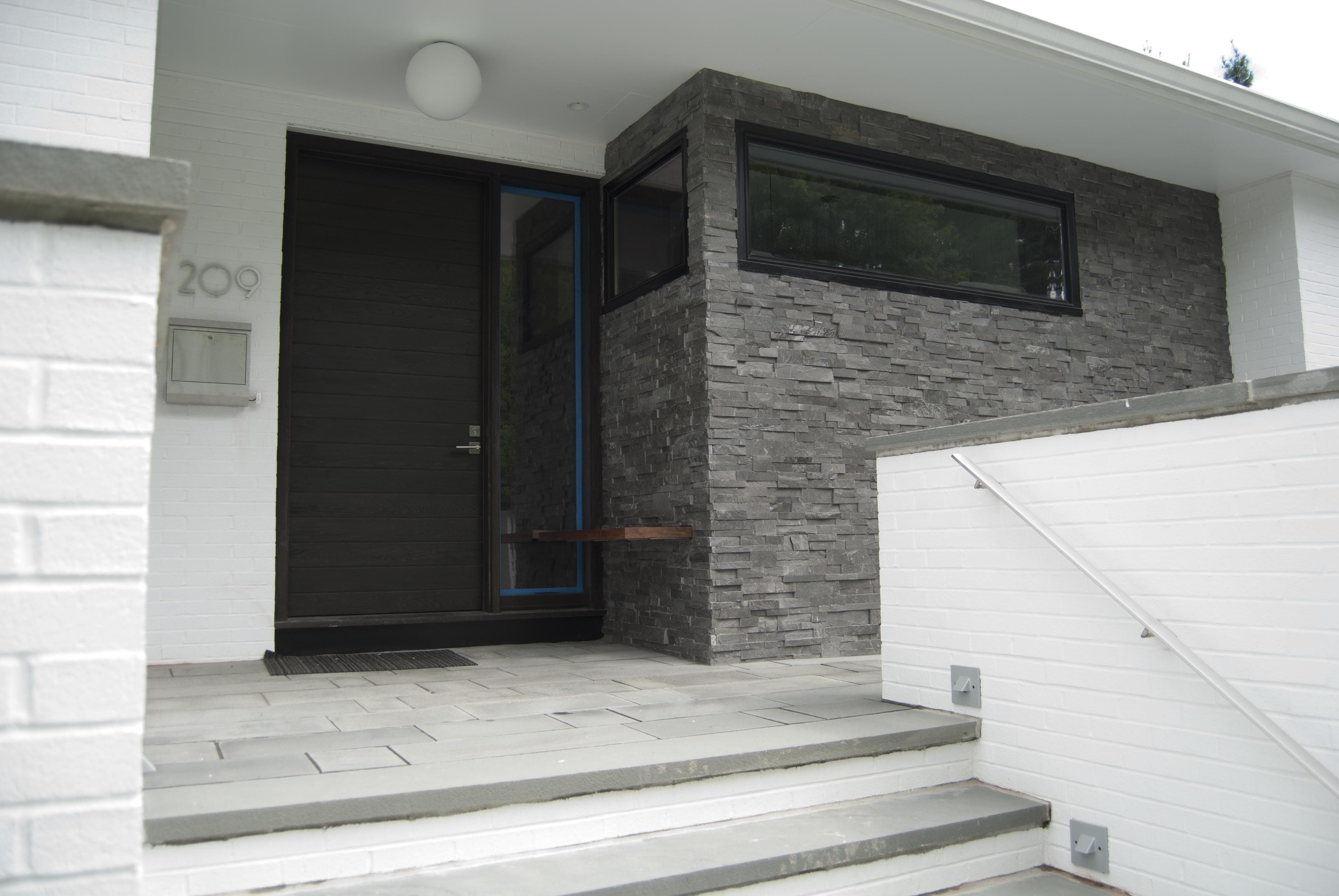 Stone Veneer on Facade of Mid Century Modern Home with White Brick