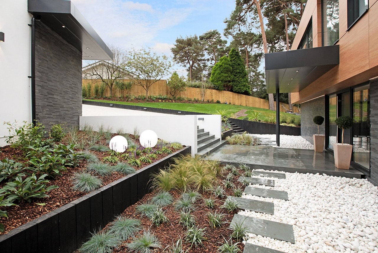 Norstone Aksent 3D Grey Stone Veneer used on two buildings seperated by modern landscaping and hardscaping