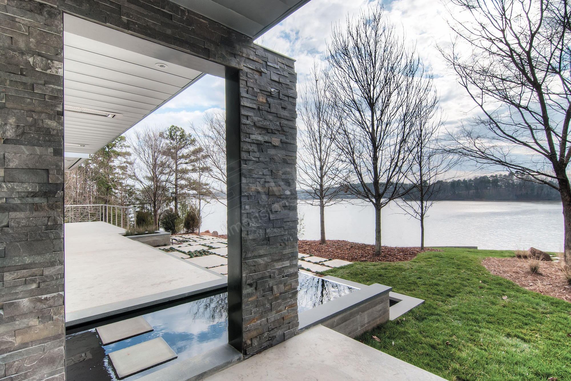 Dry stack stone veneer used exterior on a North Carolina Lake in a freeze thaw climate