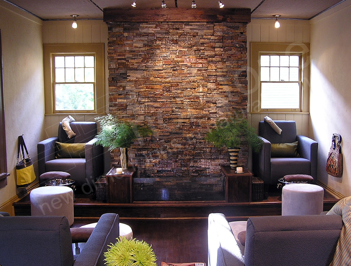Interior stacked stone water feature wall