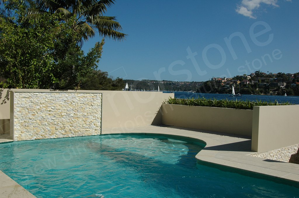 Ivory Stacked Stone that has been sealed used on a pool feature wall