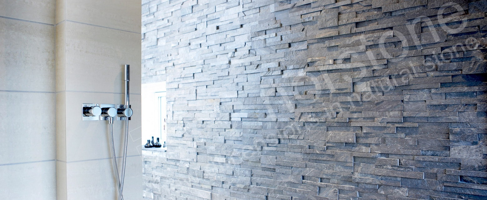 Charcoal Rock Panels used on an accent wall in a large walk in doorless shower