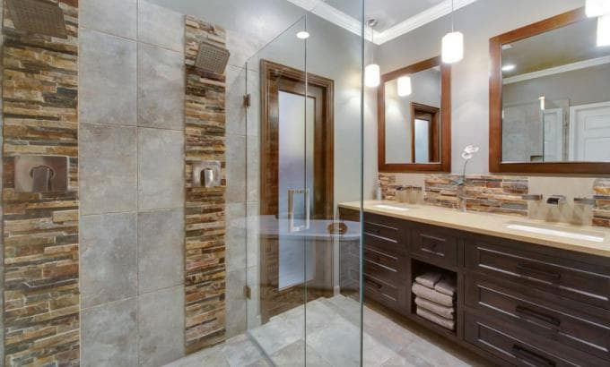 Modern Shower with vertical stacked stone accent strips set in porcelain tile
