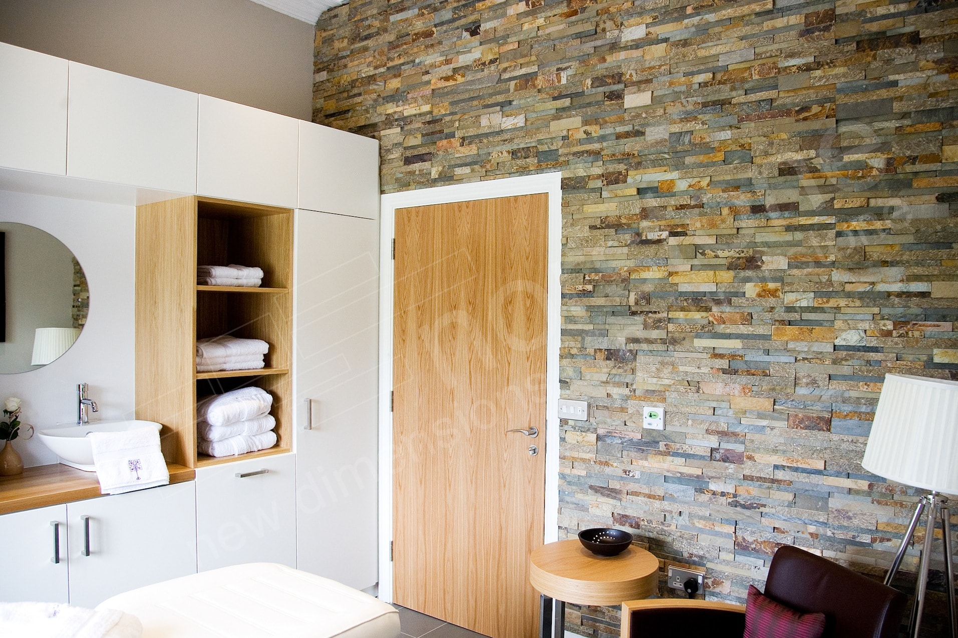 Stacked Stone Veneer Panels on a feature wall in a spa like treatment room at an assisted living facility