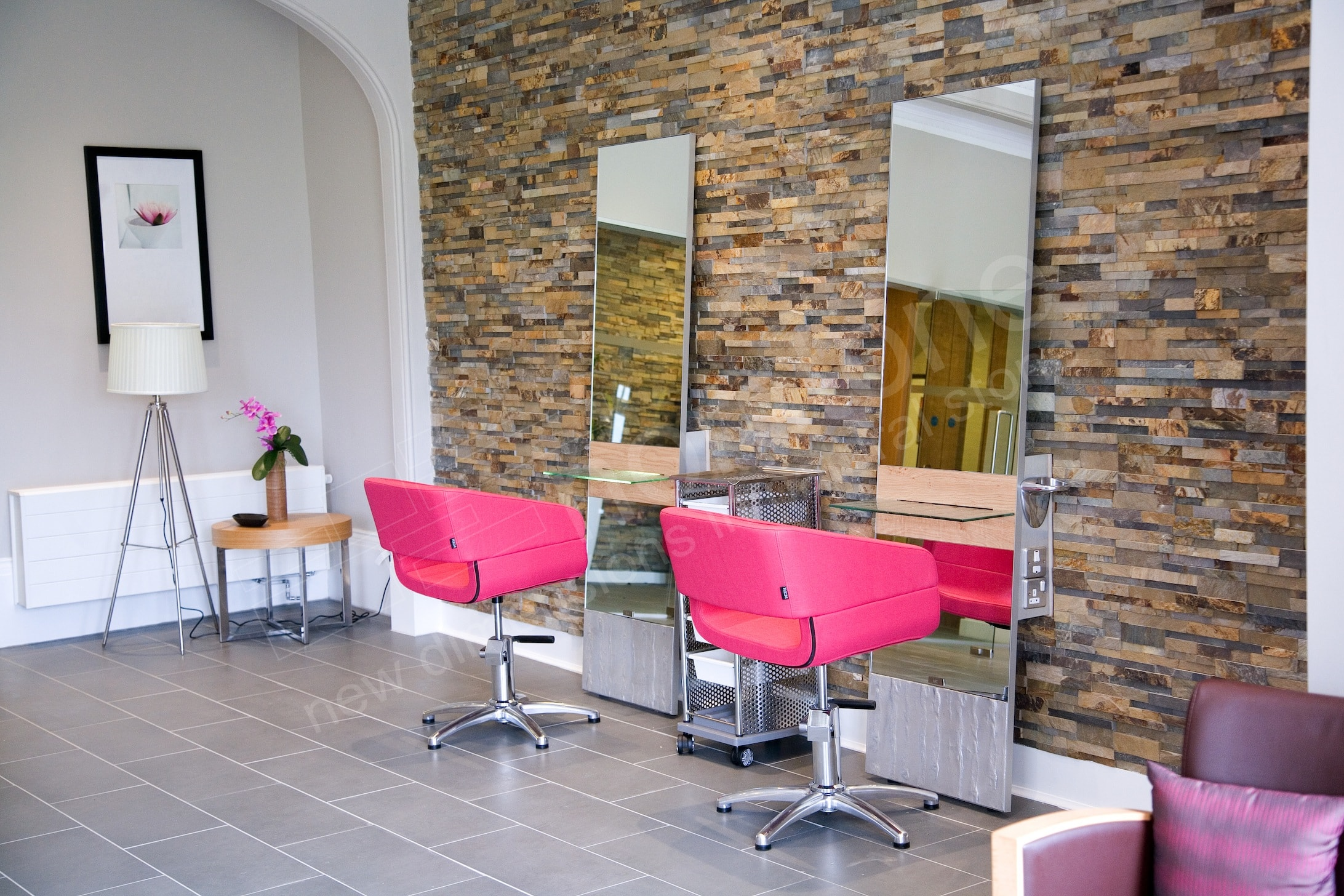 Natural Stacked Stone Panels used on the feature wall in a small hair salon with two chairs and two large mirrors
