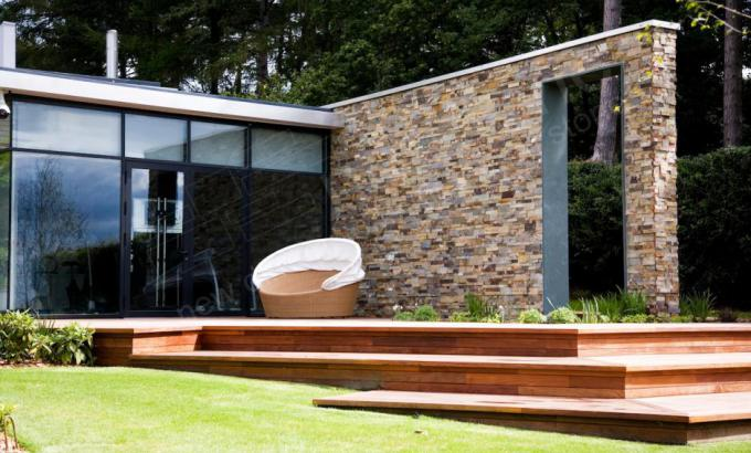 Norstone Large Format XL Series Rock Panel used as stone siding on a modern home in the UK