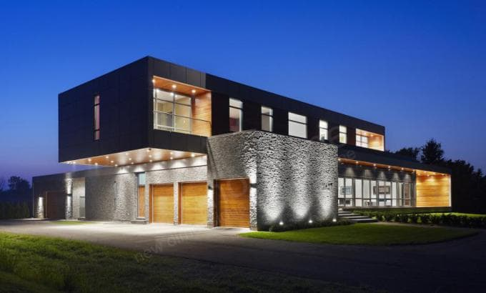 Norstone Charcoal Rock Panels used as a primary stone siding feature on a large modern designed home in Niagra Falls