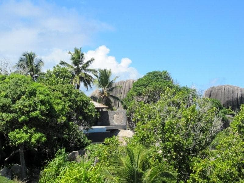 Norstone Charcoal Rock Panels used on a resort in the Seychelle Islands in Africa with Granite Domes in the background