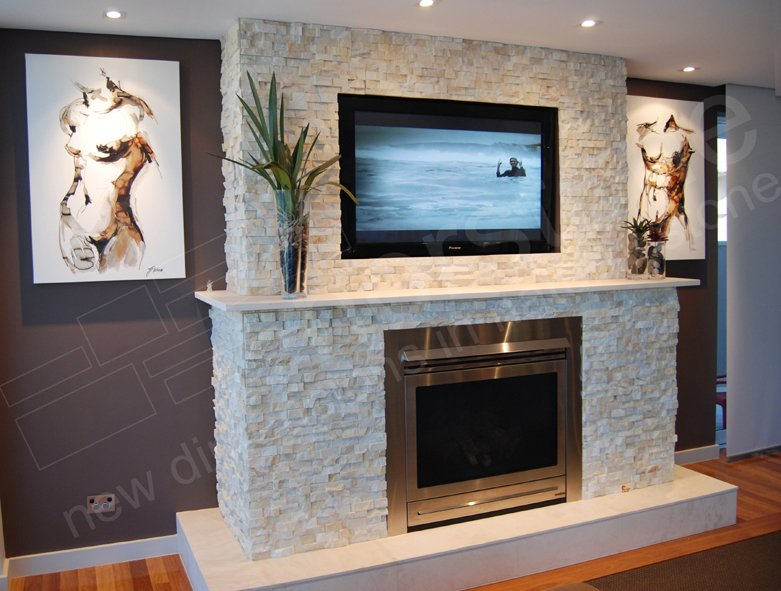 Norstone Ivory Quartz Stacked Stone Panel used on a fireplace