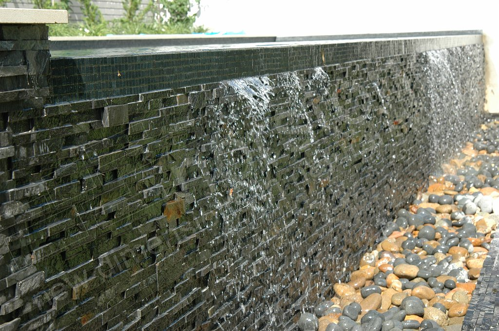Norstone Charcoal Rock Panels used on the spillway of a large outdoor water feature