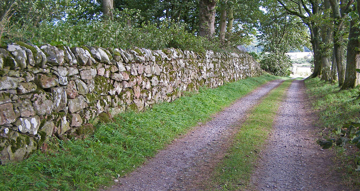Loose stone hand stacked in a traditional technique to create a stone property dividing wall