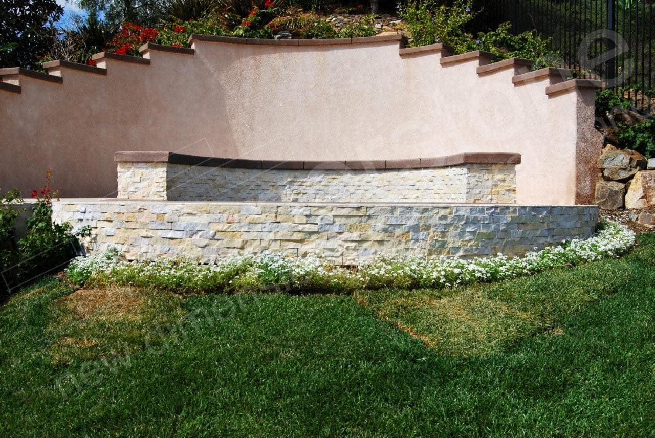 Stacked Stone Veneer panels used on the curved walls of a raised spa