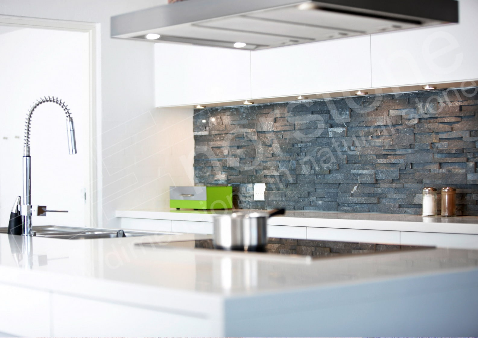 Norstone Charcoal Rock Panels installed on cement board over existing drywall on a modern kitchen backsplash
