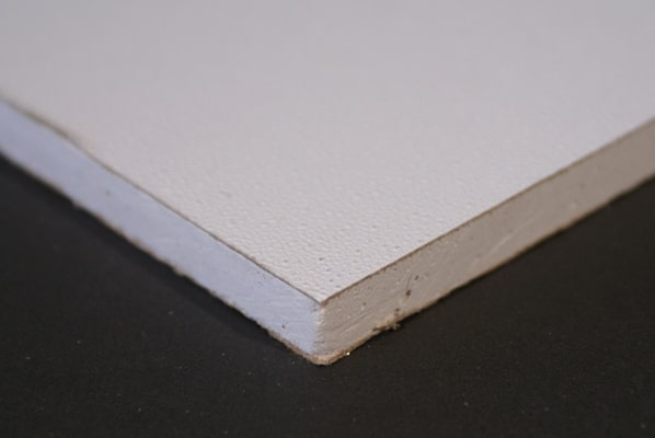 Side profile view of a piece of drywall showing the paper outer layers