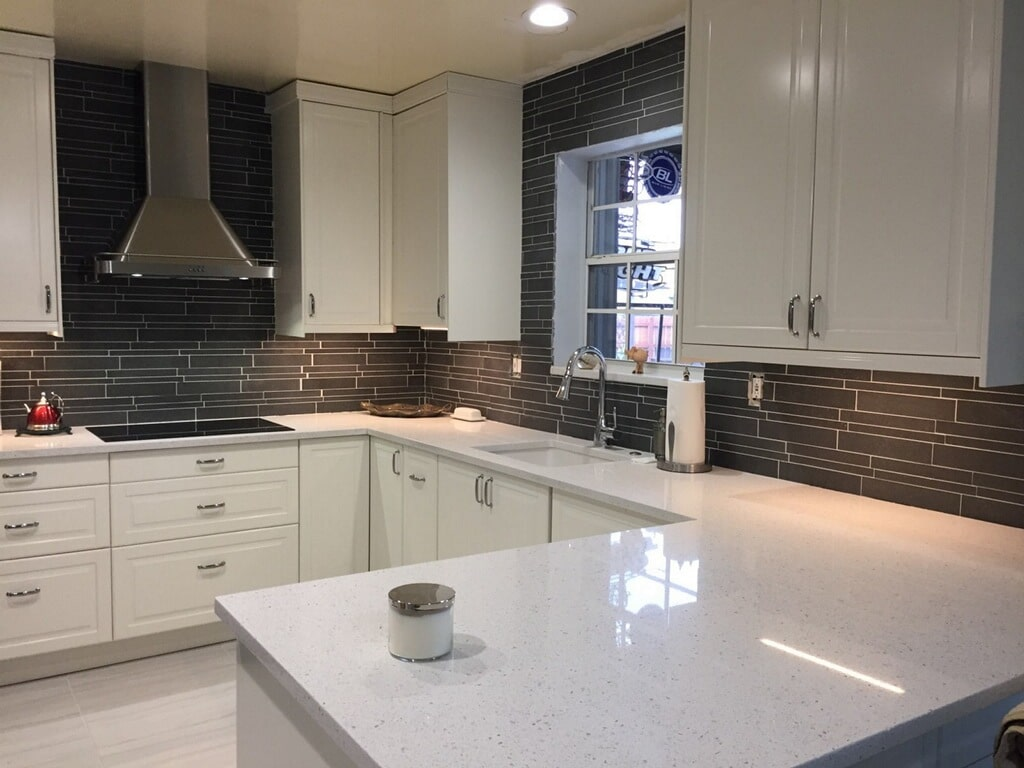 Norstone Ash Grey Lynia Interlocking Tile on a backsplash tile with LED under cabinet lighting
