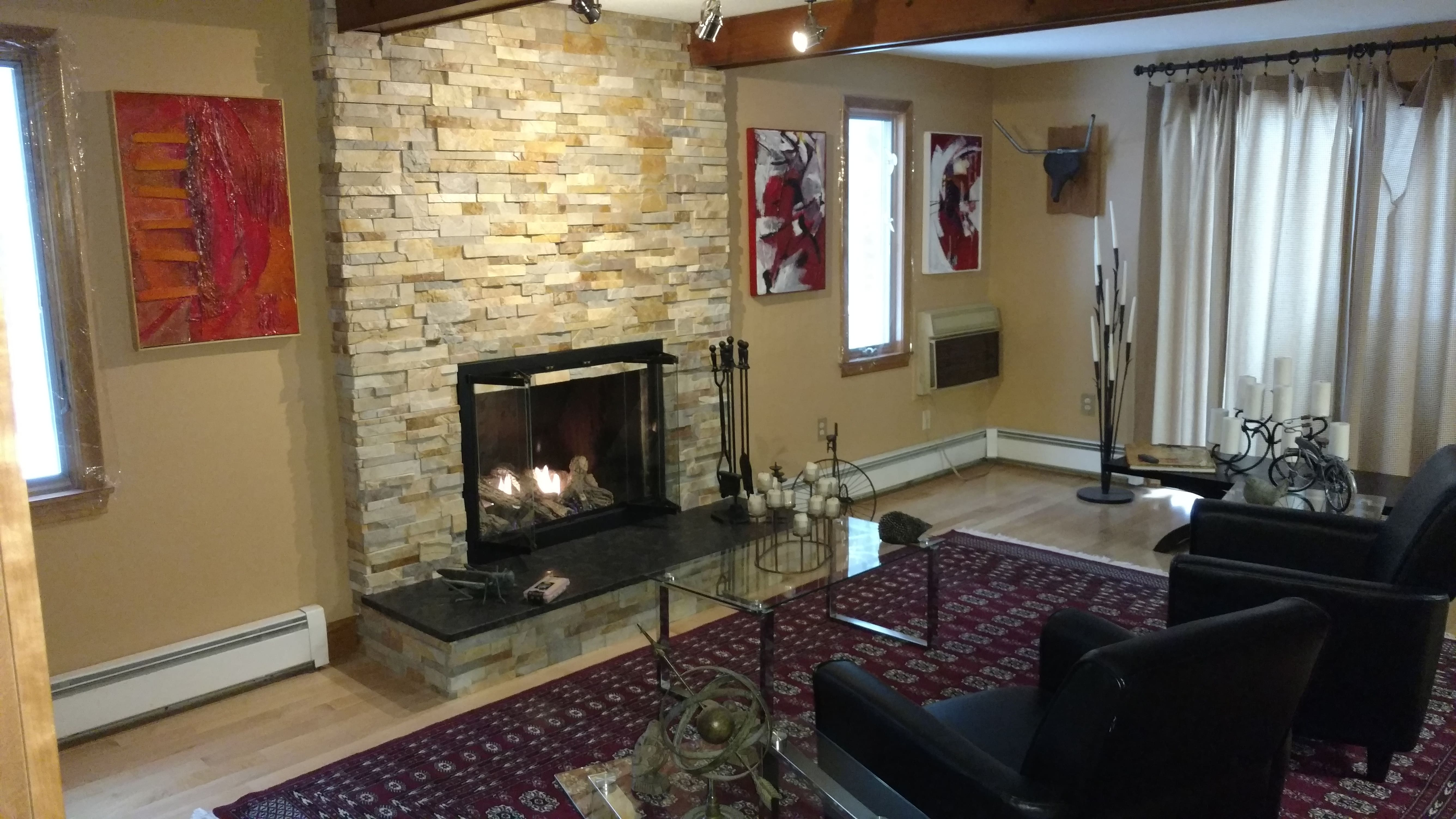 Norstone Aztec XL Stone Veneer Fireplace Remodel Project with new granite hearth stone