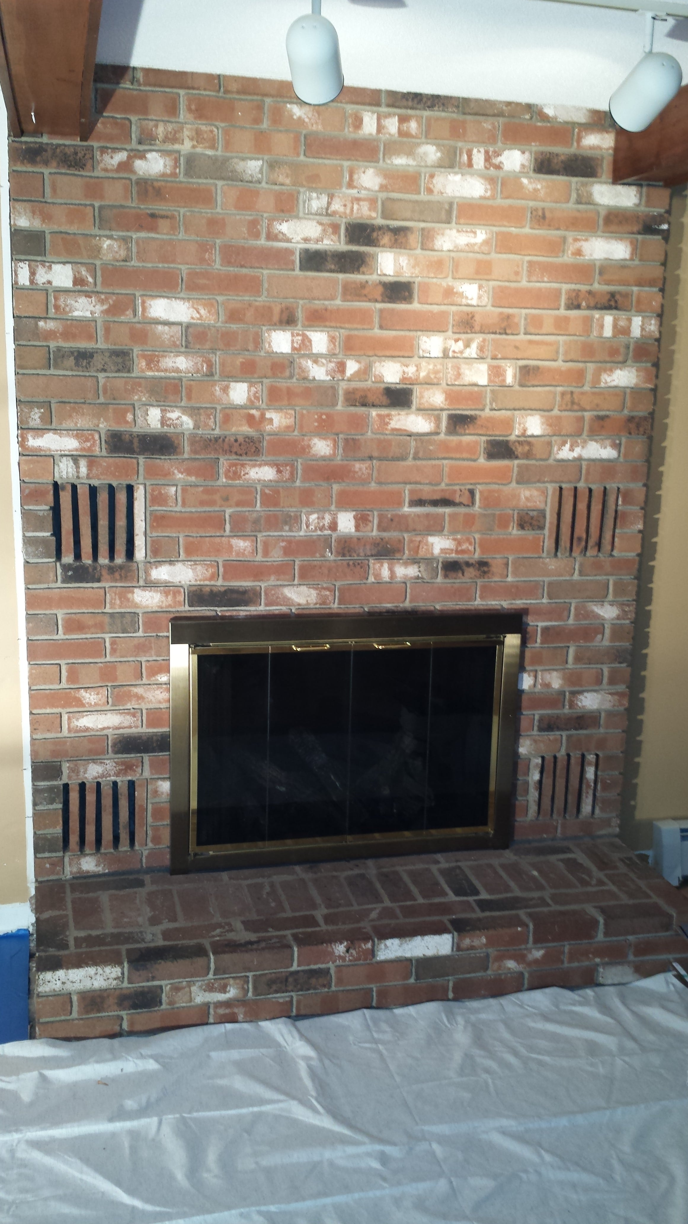 Before photo of an old brick fireplace set to be redone with Norstone Aztec XL Stone Veneer