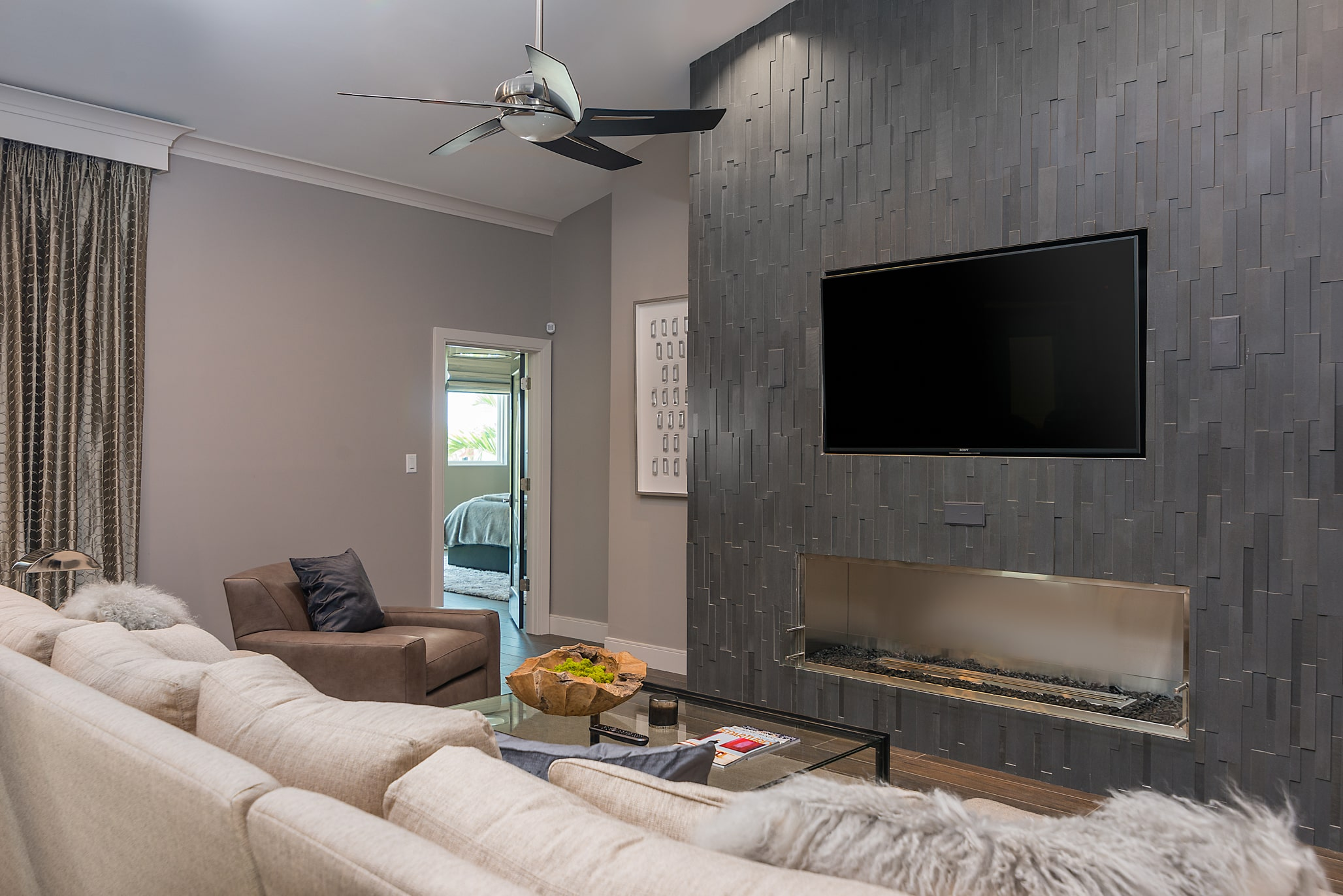Norstone Grey Aksent stone veneer used vertically with a modern gas fireplace with no hearth