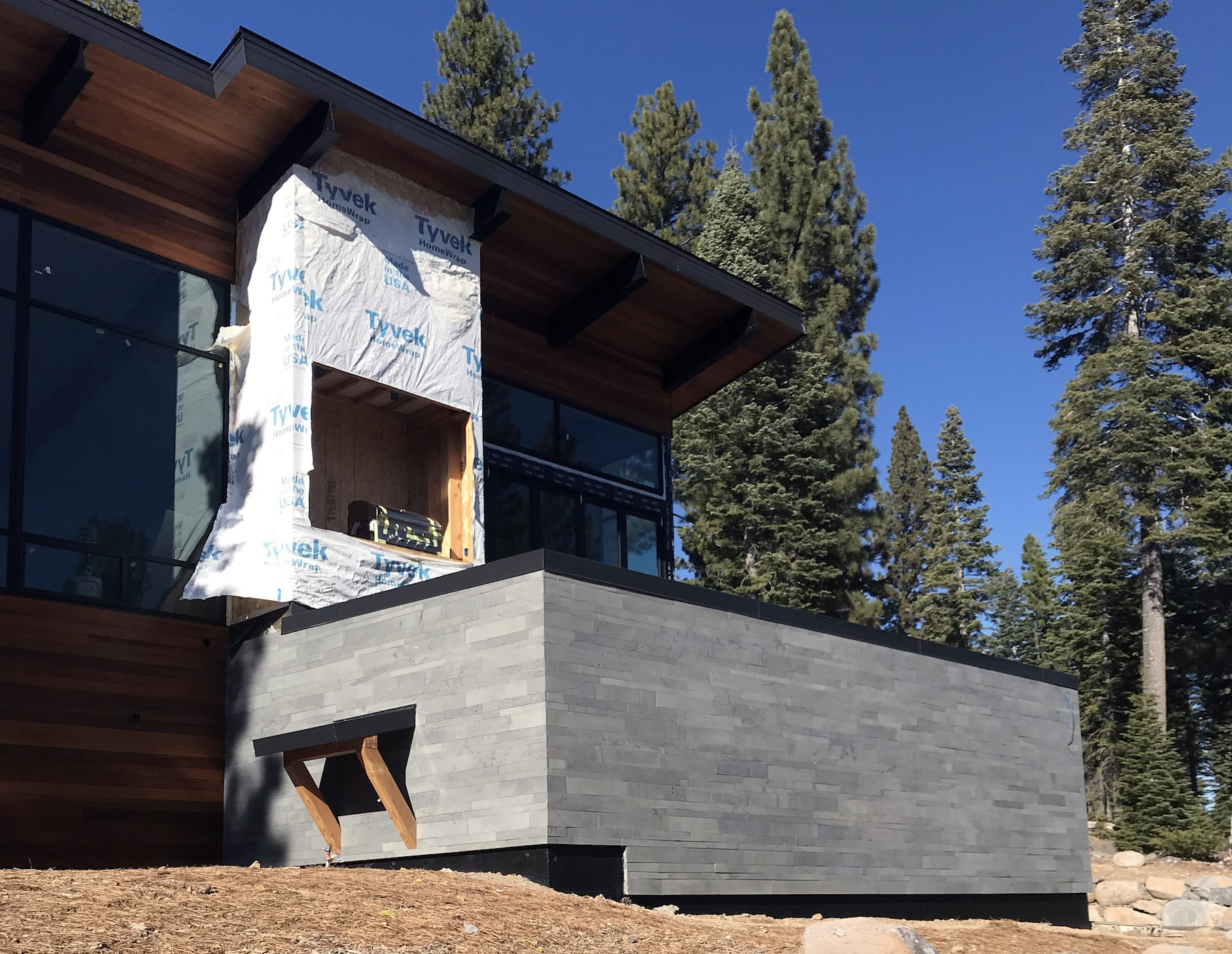 Norstone Platinum Planc Large Format Tile on a residential exterior feature wall on a hillside home in Reno