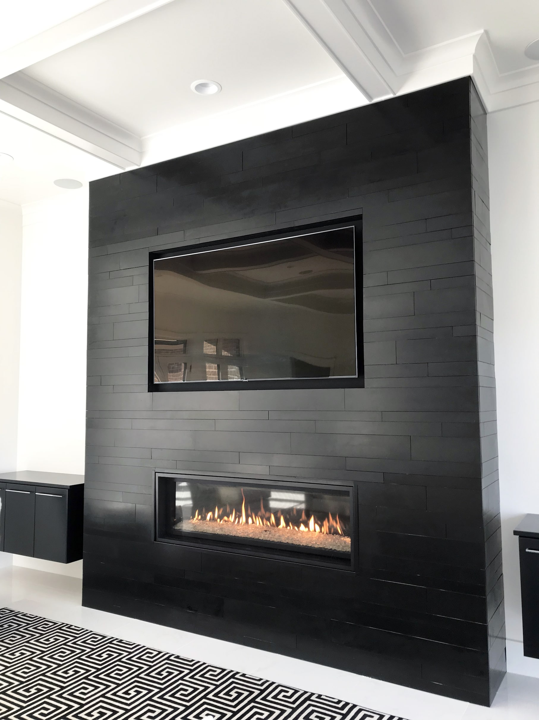Norstone Planc Large Format Tiles in Ebony installed on a modern fireplace with outside corners