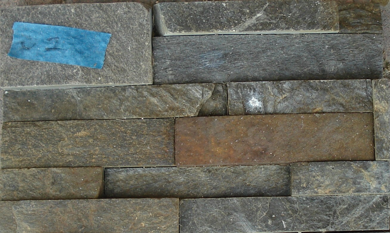 Norstone Charcoal Rock Panels that were tested with undiluted muriatic acid resulting in oxidation