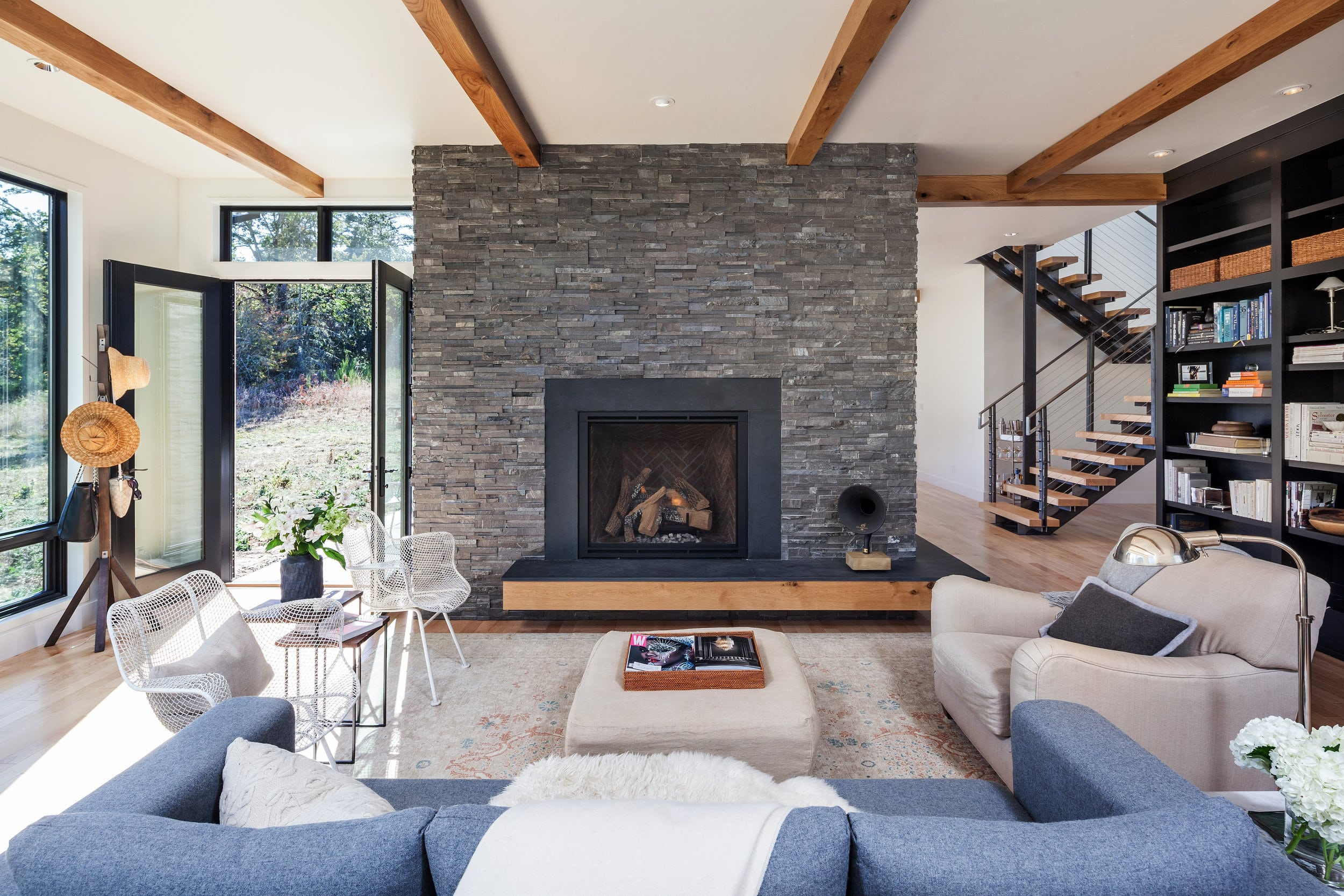 Norstone Charcoal Rock Panels used as the natural stone wall veneer on a fireplace project for Improved Indoor Air Quality