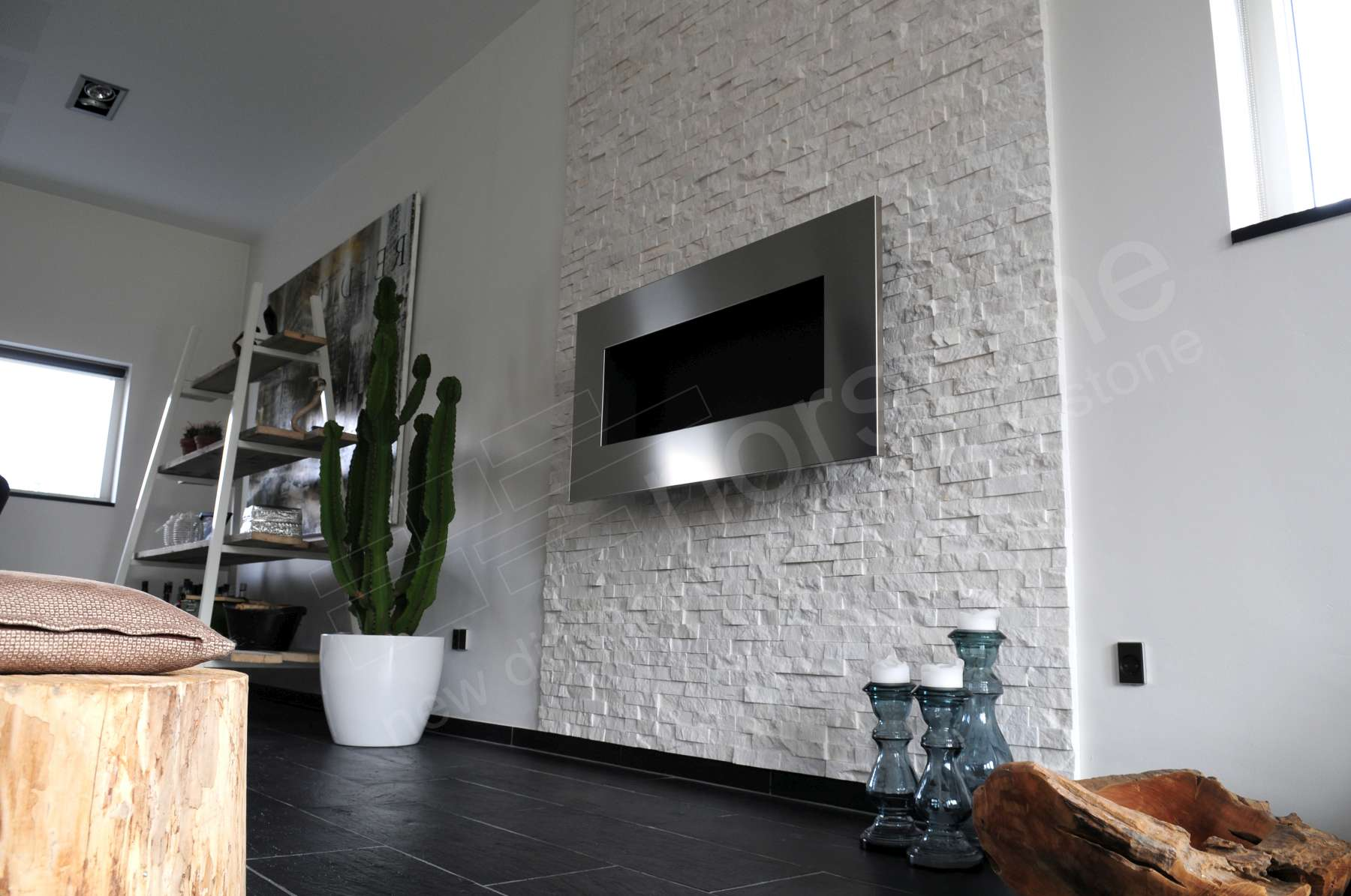 Norstone White Rock Panels on thin fireplace in Denmark with a large chest level staineless steel fireplace