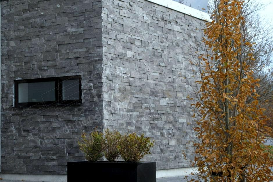 Norstone Charcoal XL Stone Veneer Panel used on the side exterior wall of a modern designed residential home on Long Island