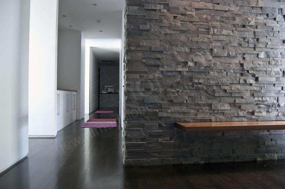 Norstone Natural Stone Veneer XL Series Charcoal Rock Panel used on a foyer wall with a built in cantilevered simple wooden bench