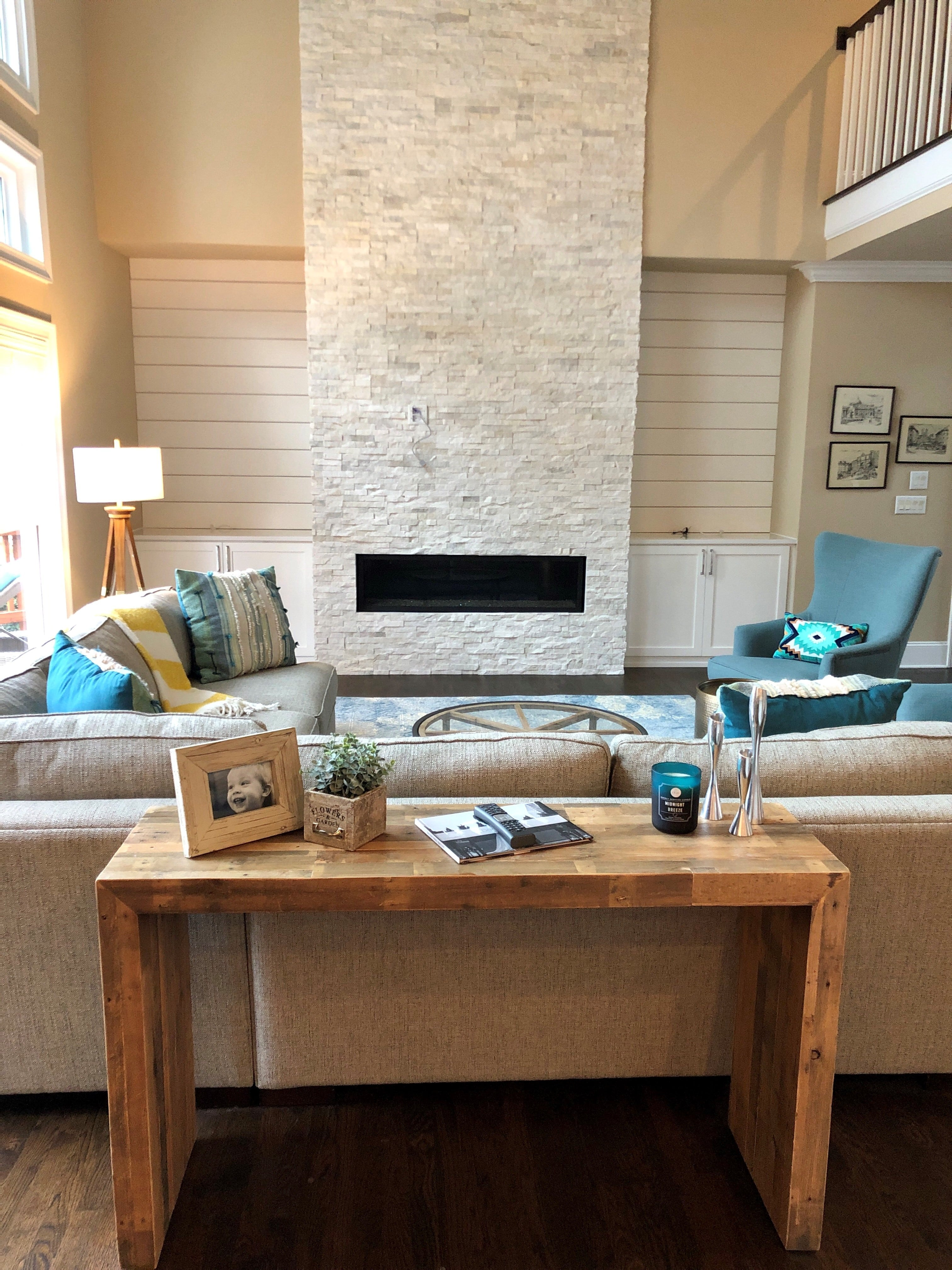 Norstone White Rock Panels used on a two story residential fireplace with a well designed living room with neutral color pallete with light blue accents
