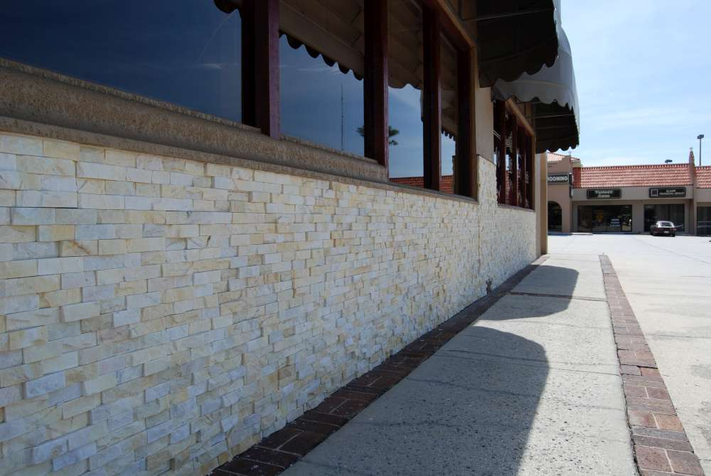 Stone veneer installed over an EIFS System on a commercial restaurant project with stucco above the stone