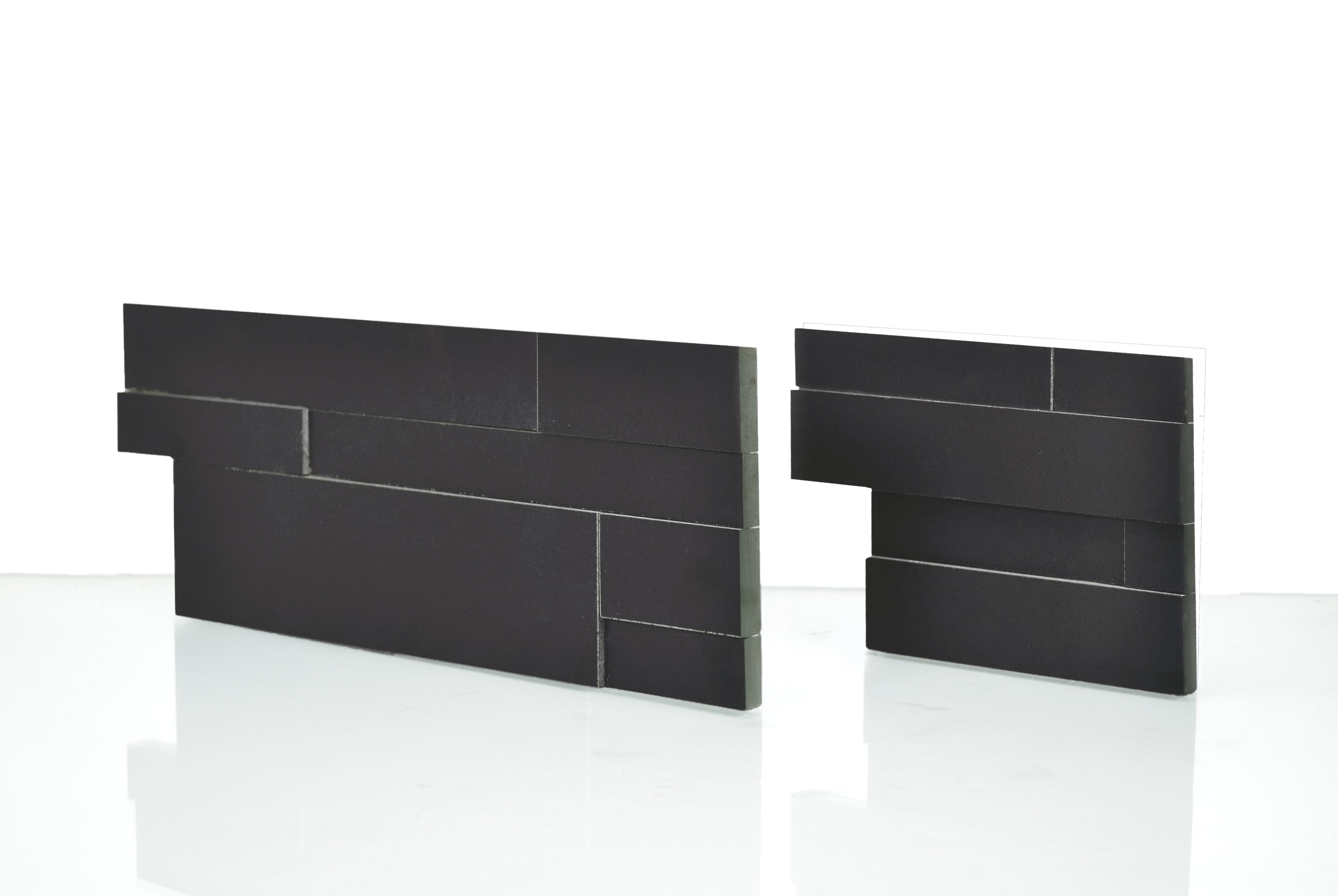 Studio Shot of a Natural End Panel of the Norstone Aksent 3D Series Stone Veneer Panel in Ebony Basalt