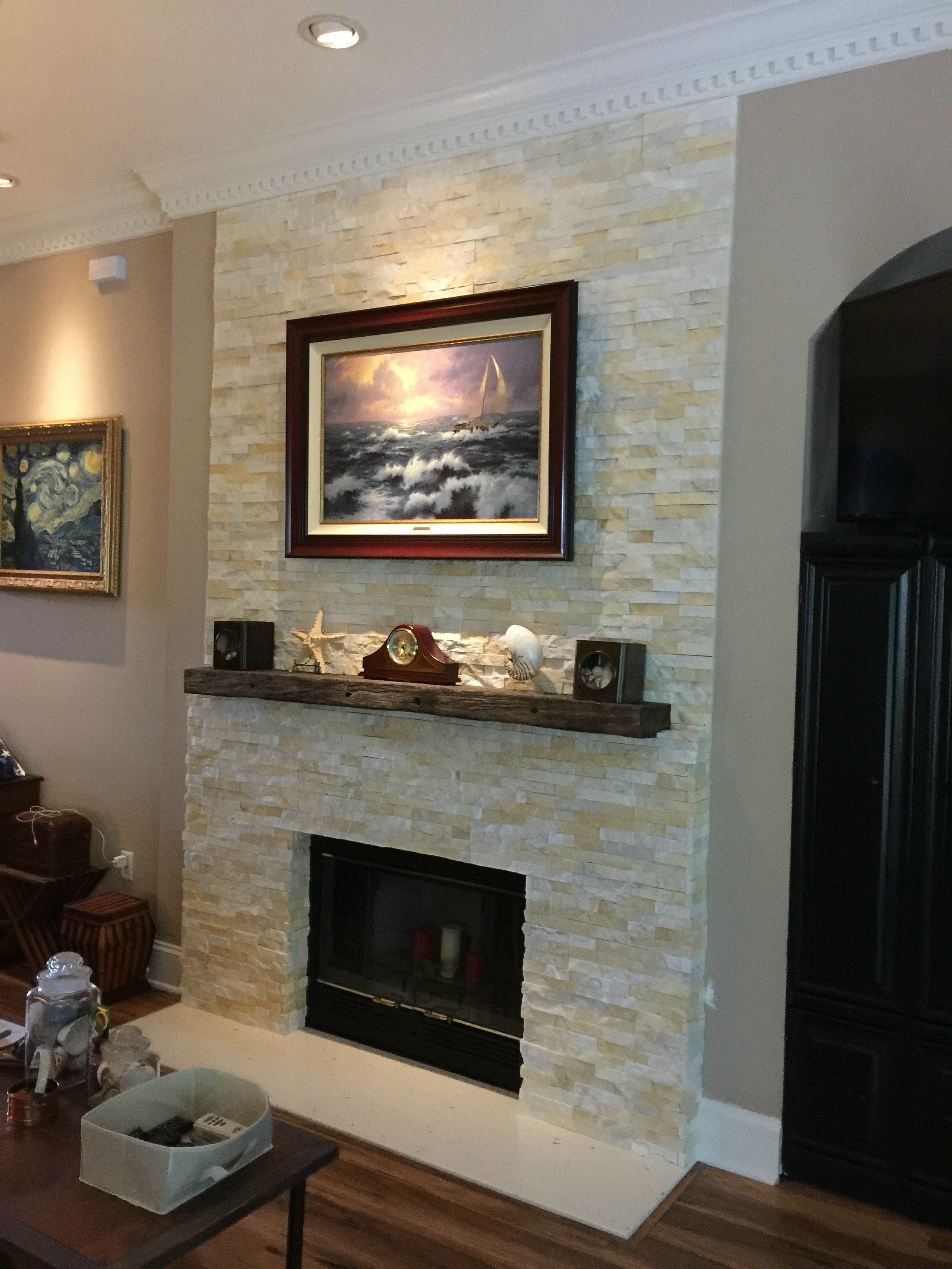 Norstone Natural End Stone Veneer Panels in Ivory color used on a residential fireplace remodel project
