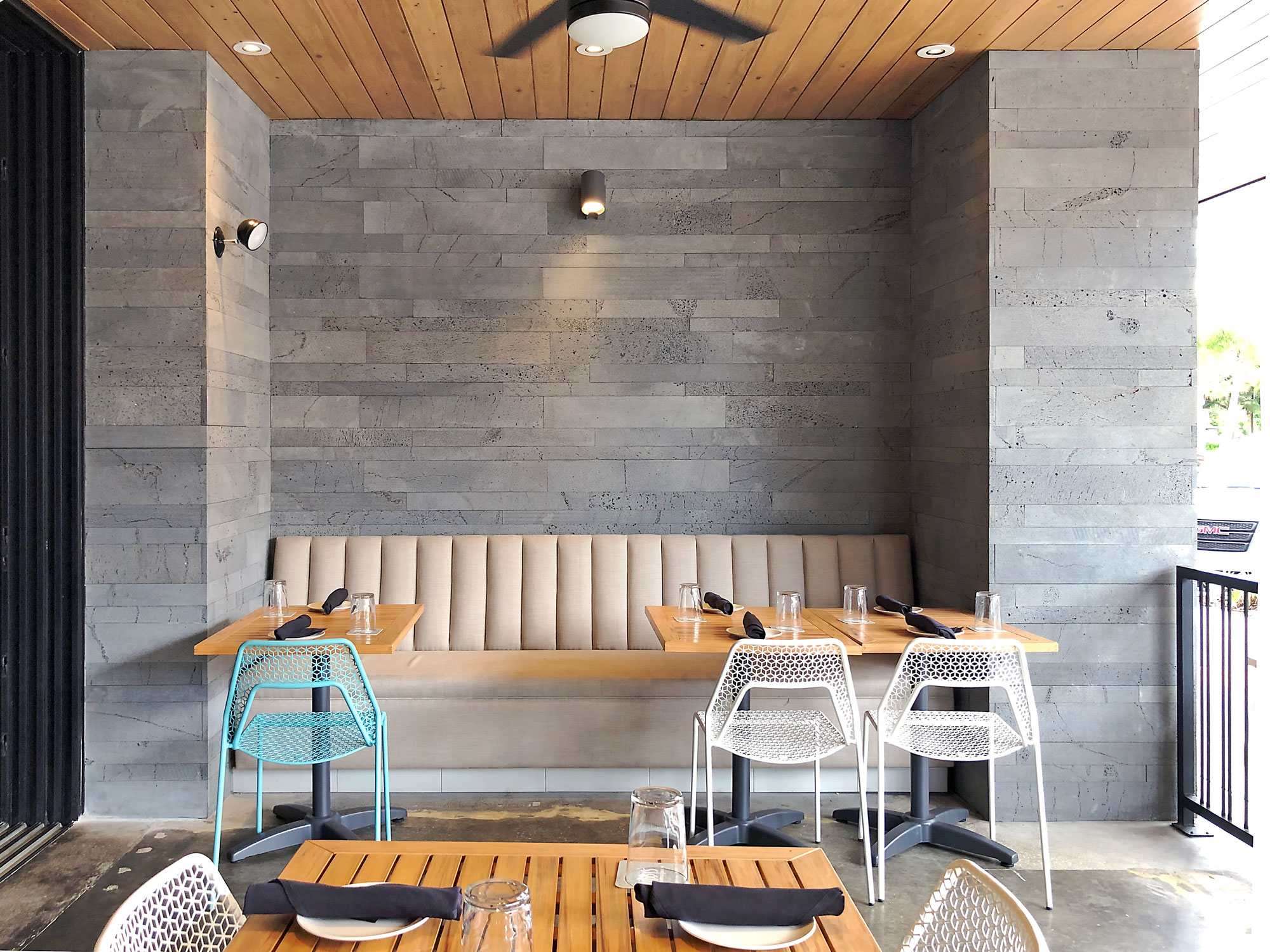 Norstone Platinum Planc Large Format Wall Tile featured in the outside dining area of Libby's restaurant in Sarasota, FL