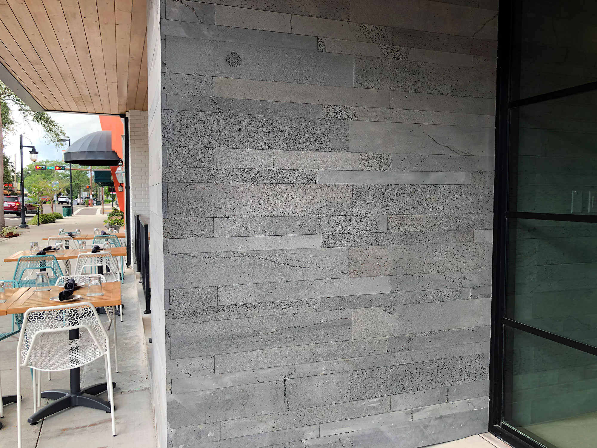 Norstone Platinum Planc Large Format Wall Tile on the exterior entry way wall of Libby's restaurant in Sarasota, FL
