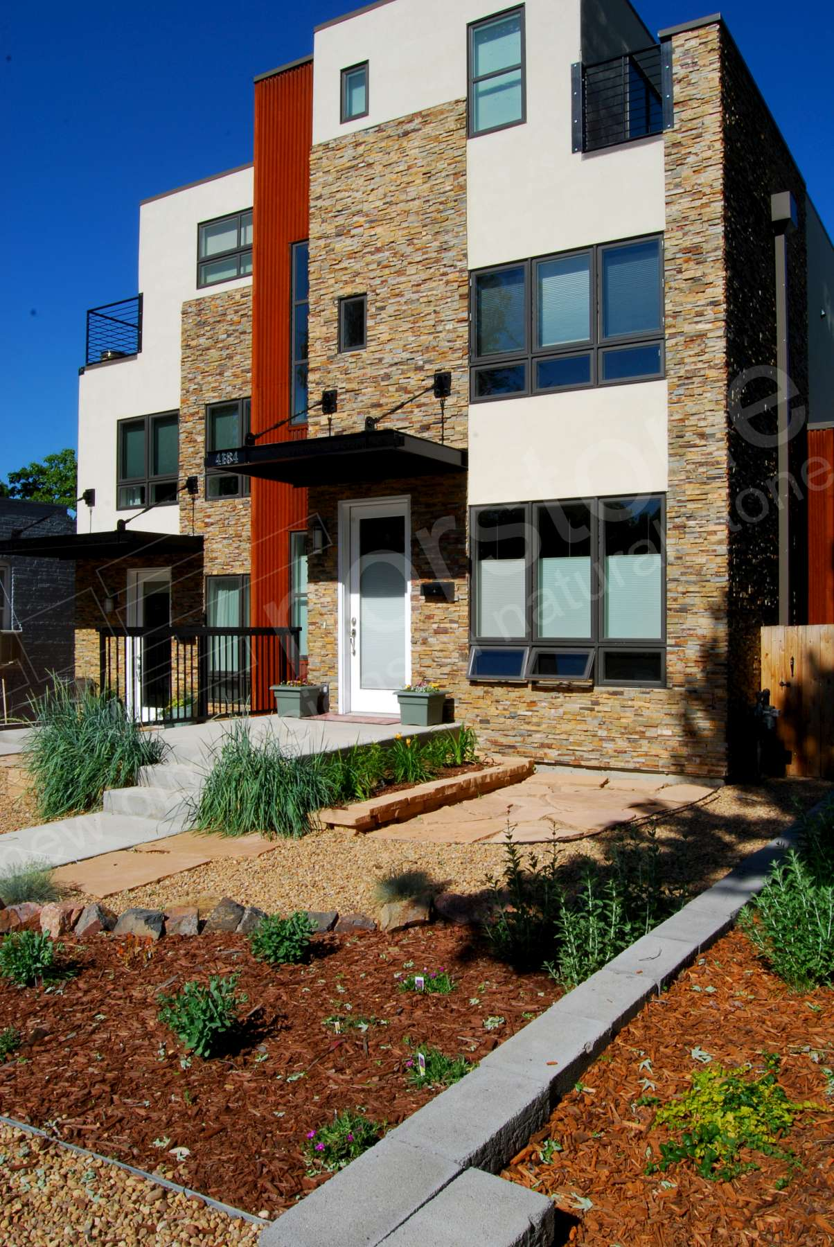 Norstone Ochre Stacked Stone Rock Panels on entryway and front facade of duplex in Colorado