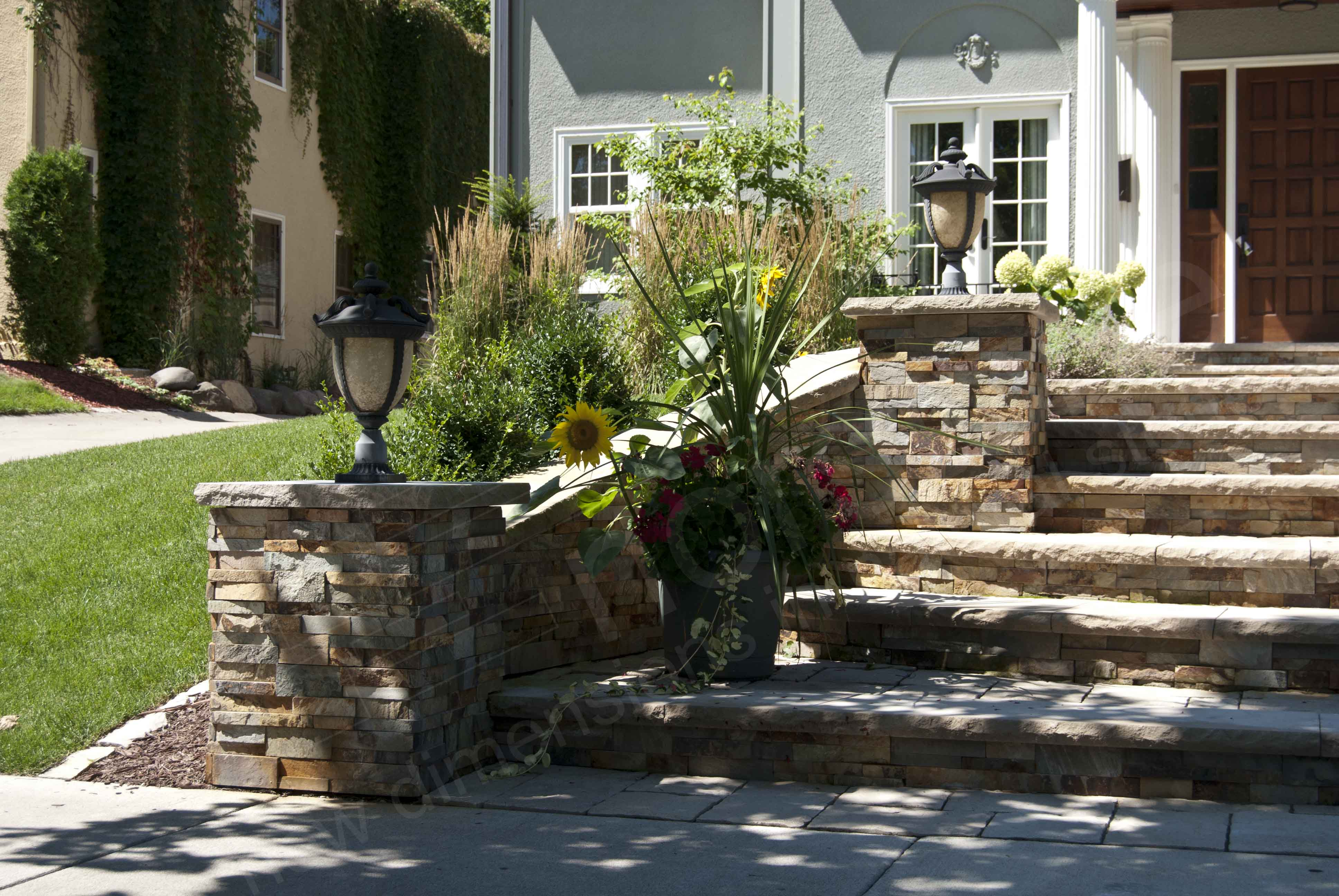 Norstone XL Series Ochre Rock Panel on entryway steps and retaining wall
