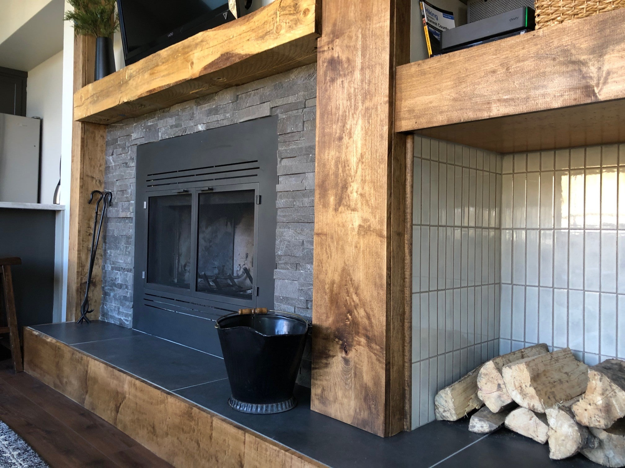 Norstone Charcoal Rock Panels surrounding black metal fireplace insert in Colorado mountain ski condo