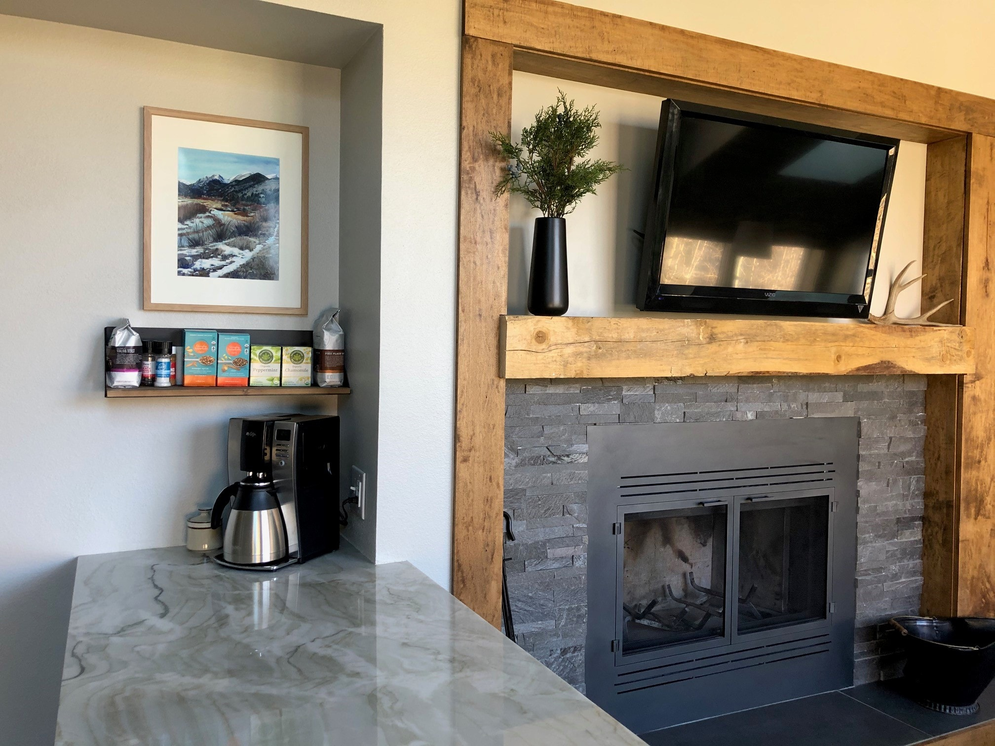 Norstone Charcoal Rock Panels surrounding fireplace with rough hewn wooden accents in Colorado mountain ski condo