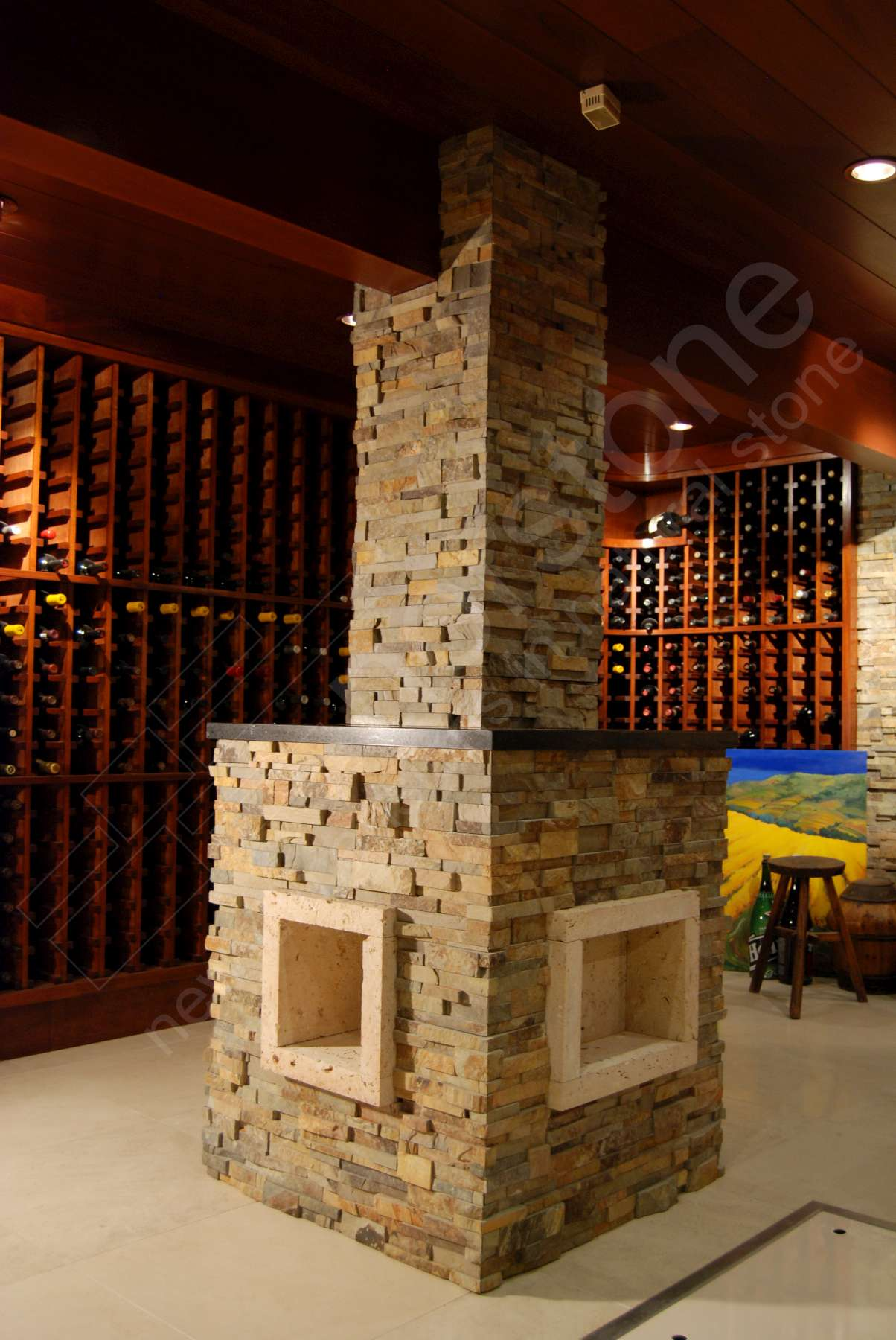 Norstone Ochre Stacked Stone Rock Panels on a column with miter cut corners on an underground Wine Cellar in California