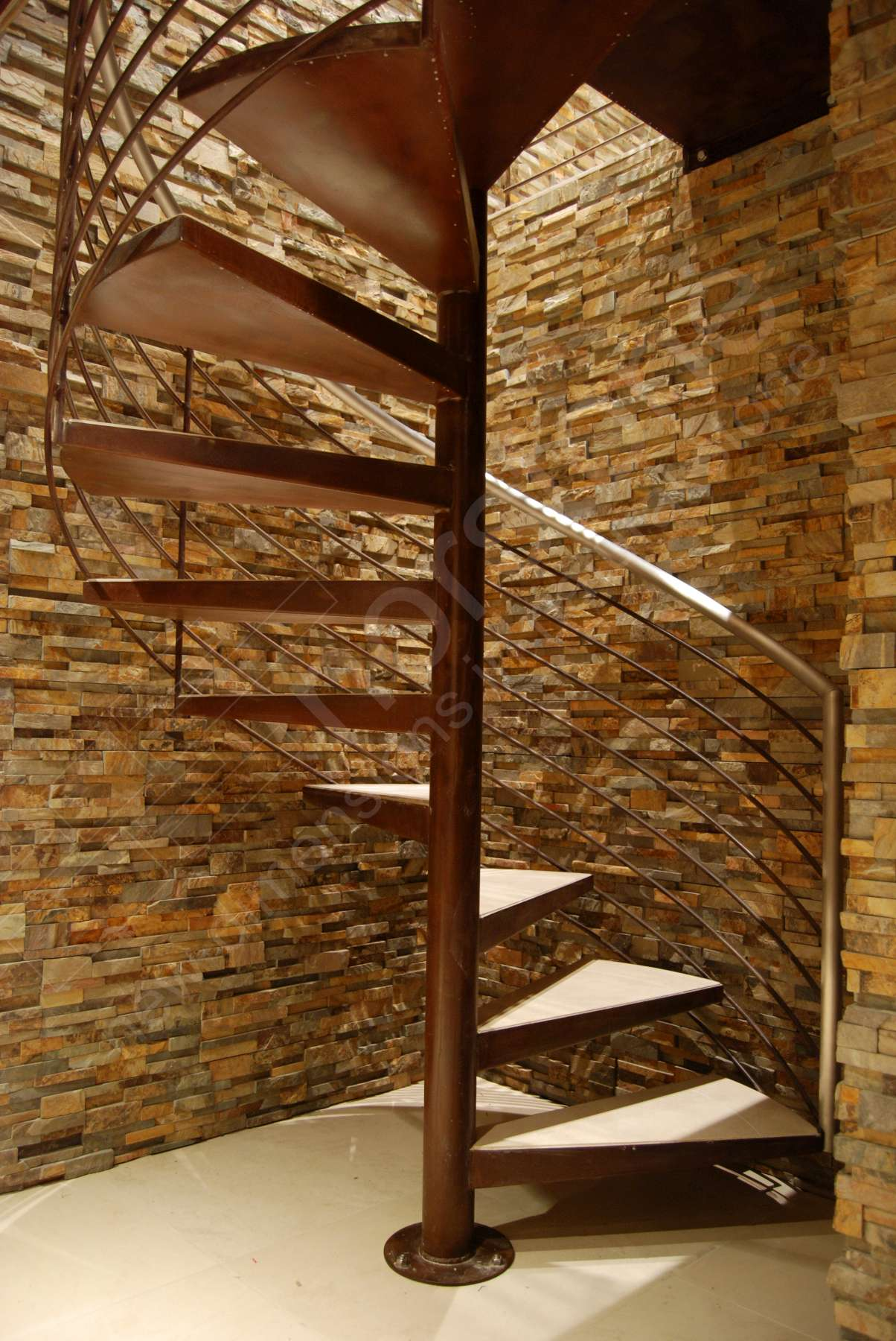 Norstone Ochre Stacked Stone Rock Panels in stairwell of spiral staircase of an underground Wine Cellar in California
