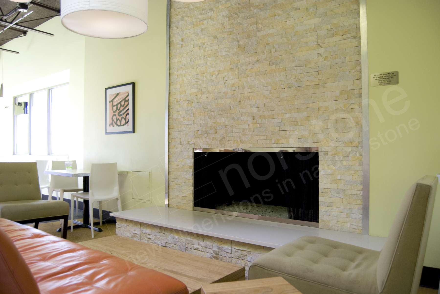 Norstone Ivory Stacked Stone Rock Panels installed on a fireplace as part of a retail space build out