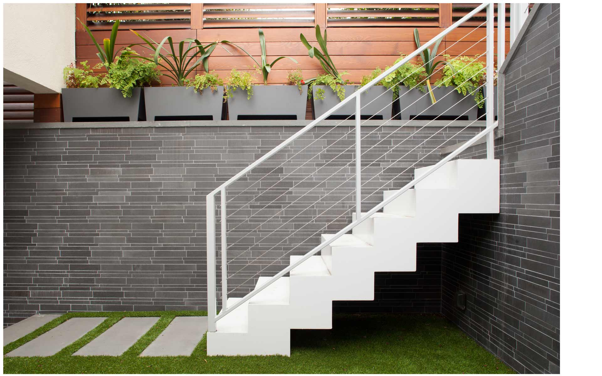 Norstone Grey Basalt Lynia Interlocking Tile Feature Wall in San Francisco Interior Courtyard showing tile pattern on wall