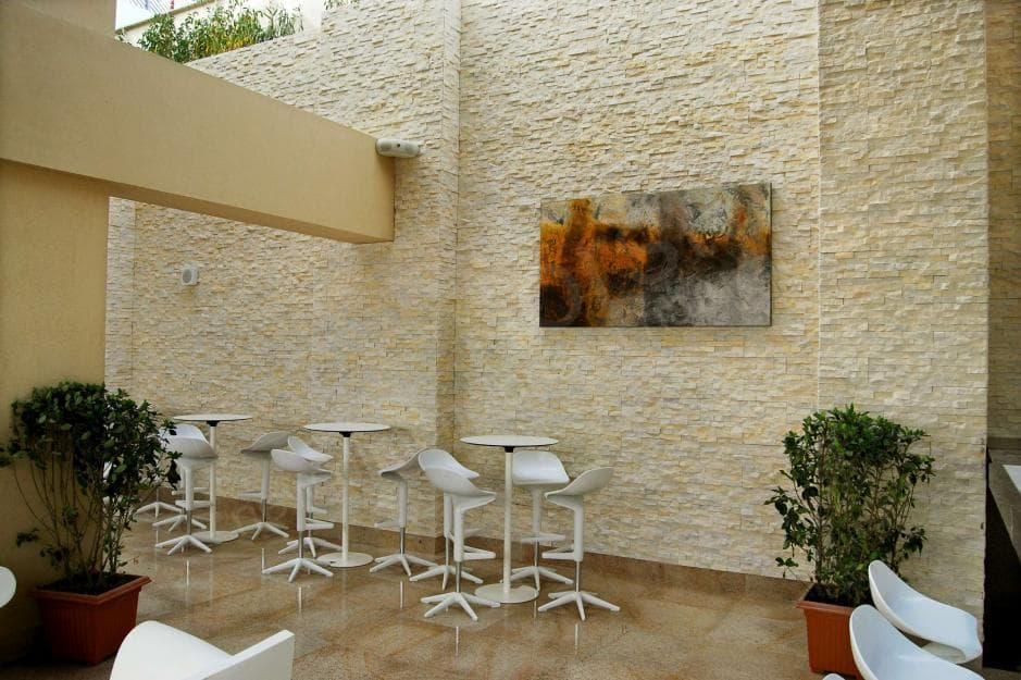Norstone Ivory Rock Panels on large wall at a restaurant in Abu Dhabi