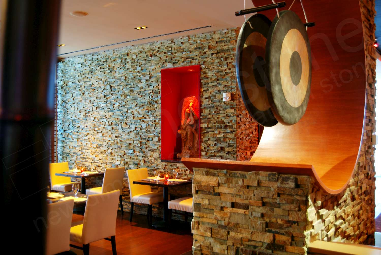 Norstone Ochre Blend Stone Veneer Rock Panels on a column and feature wall at Susanna Foo's restaurant in Pennsylvania