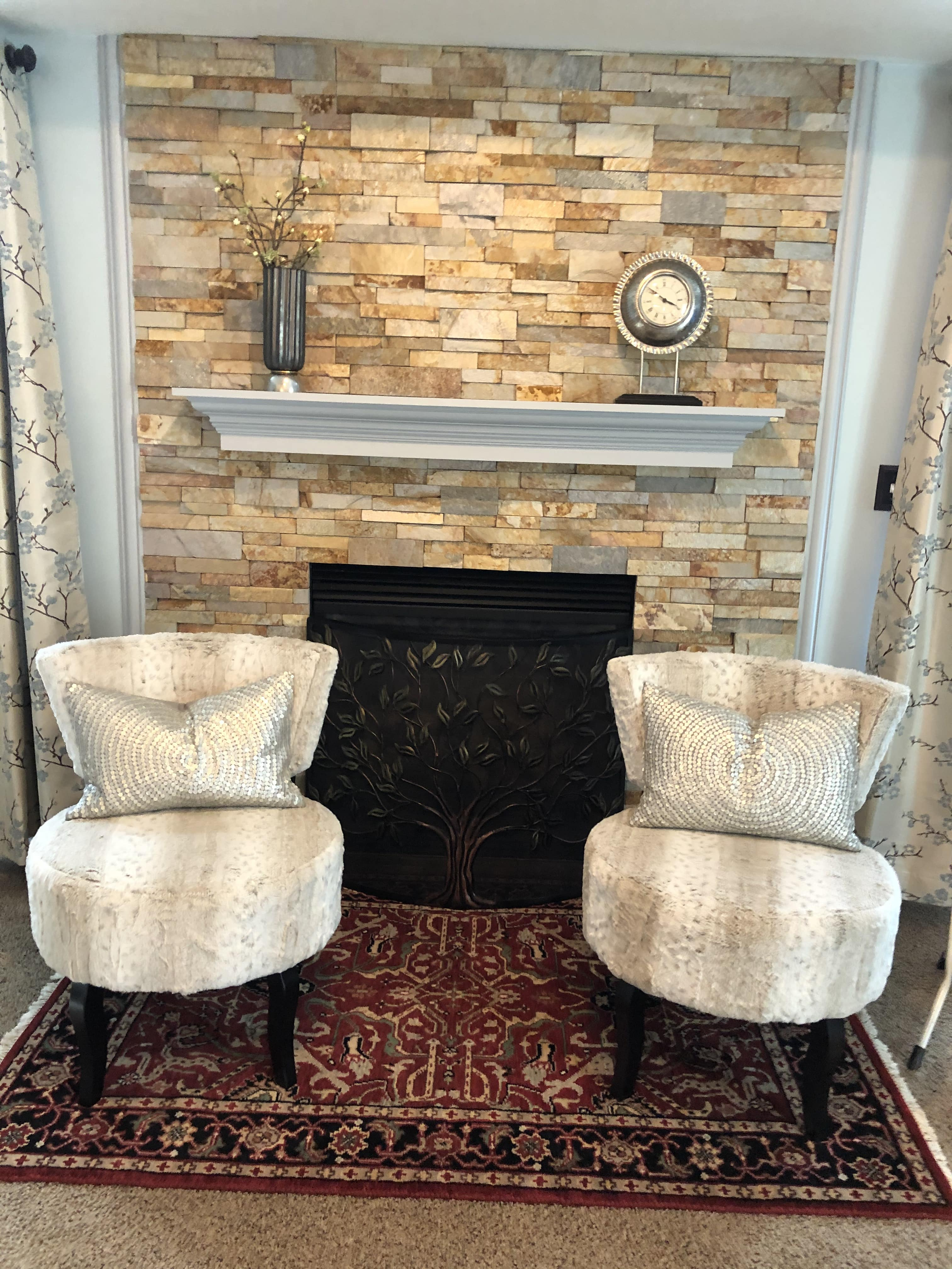 After photo of a renovated residential fireplace with Norstone Aztec XL Series Rock Panels installed from floor to ceiling